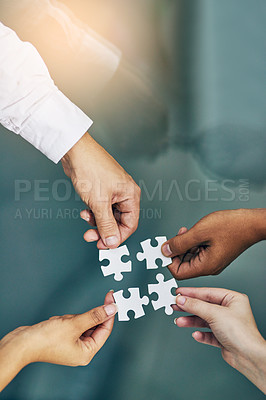 Buy stock photo Shot of hands putting puzzle pieces together