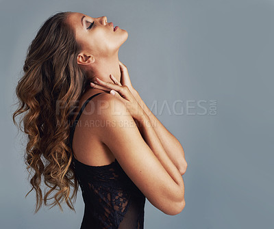Buy stock photo Cropped shot of an attractive woman wearing sexy underwear against a grey background