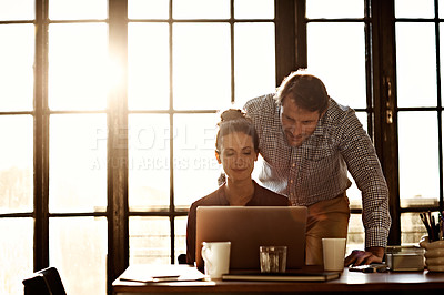 Buy stock photo Shot of a mature couple working on a laptop together at home