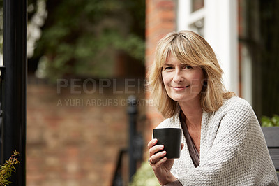 Buy stock photo Portrait of a mature woman sitting on her balcony drinking coffee