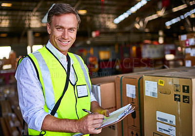 Buy stock photo Portrait of a warehouse worker standing in a large warehouse holding a clipboard