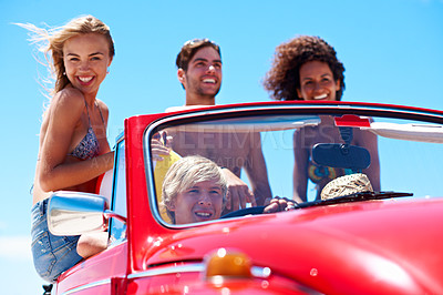 Buy stock photo Shot of a group of friends on a road trip to the beach