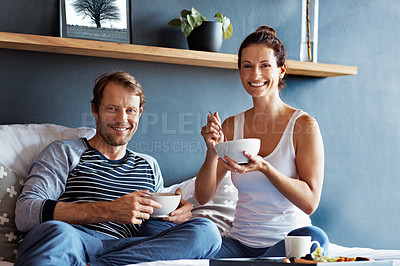 Buy stock photo Portrait of a content couple having breakfast in their bedroom