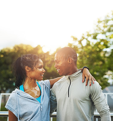 Buy stock photo Shot of a young sporty couple out for a workout