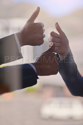 Buy stock photo Cropped shot of a group of businessmen showing a thumbs up gesture