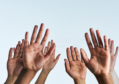 Buy stock photo Shot of a group of hands reaching up against a white background