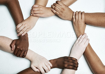 Buy stock photo Shot of a group of hands holding on to each other against a white background