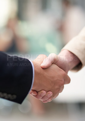 Buy stock photo Shot of a coworkers shaking hands in an office