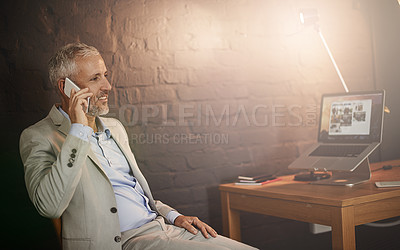 Buy stock photo Shot of a mature businessman talking on a phone