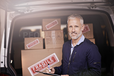 Buy stock photo Portrait of a mature delivery man standing next to a van packed with boxes