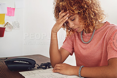 Buy stock photo Cropped shot of a young designer in her office