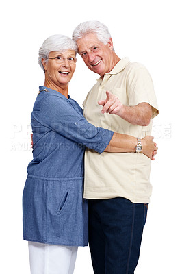 Buy stock photo Portrait of a happy old man showing something interseting to her wife against white background