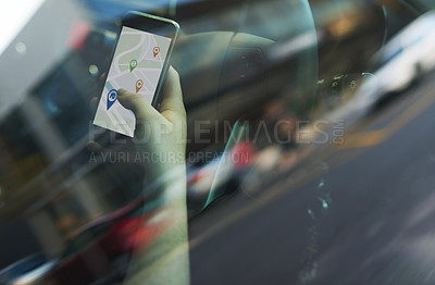 Buy stock photo Cropped shot of a woman using her phone's gps while driving