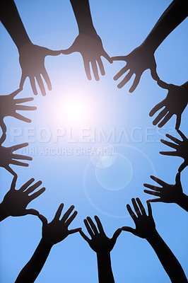 Buy stock photo Shot of a group of hands spread out together in a circle