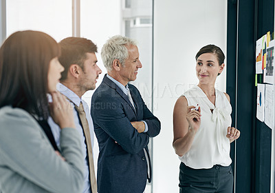 Buy stock photo Shot of a woman giving a presentation to colleagues in an office