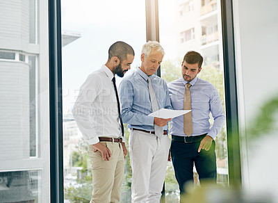 Buy stock photo Shot of a group of colleagues having a meeting in an office