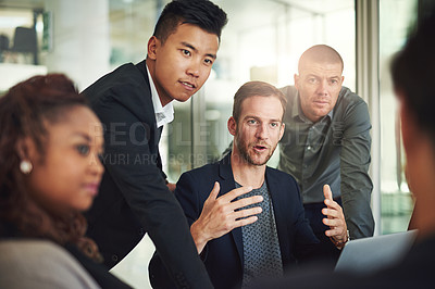 Buy stock photo Shot of a group of businesspeople meeting in the boardroom