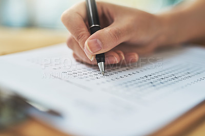 Buy stock photo Shot of a woman filling in an answer sheet for a test