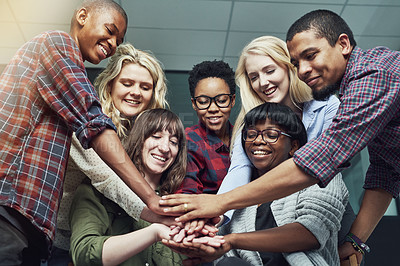 Buy stock photo Shot of a group of people putting their hands together