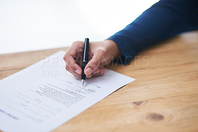 Buy stock photo Shot of a person signing paperwork