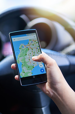 Buy stock photo Shot of a person in a car using their phone to find directions