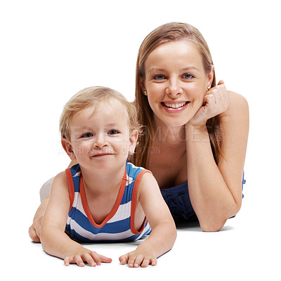 Buy stock photo Portrait of a beautiful young woman and her small kid lying together on floor over white background