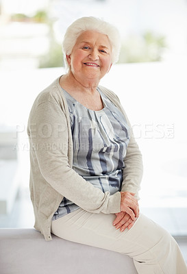 Buy stock photo Portrait of a happy senior woman relaxing on sofa at home