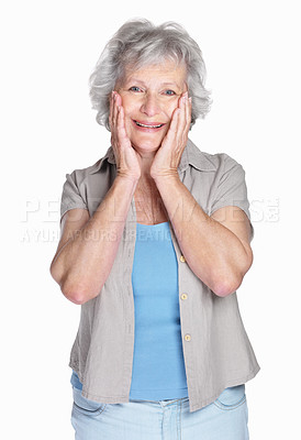 Buy stock photo Portrait of a happy senior woman with hands on chin against white background