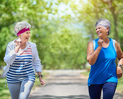 Buy stock photo Shot of two elderly friends enjoying a run together outdoors