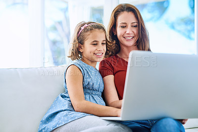 Buy stock photo Cropped shot of a mother and daughter using a laptop together at home