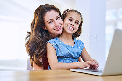 Buy stock photo Portrait of a mother and daughter using a laptop together at home