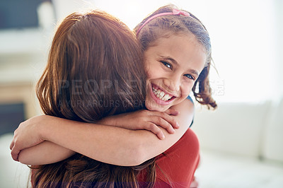 Buy stock photo Portrait of a young girl hugging her mother at home