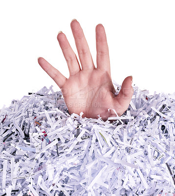 Buy stock photo Studio shot of a woman's hand reaching out from under a pile of shredded paper against a white background