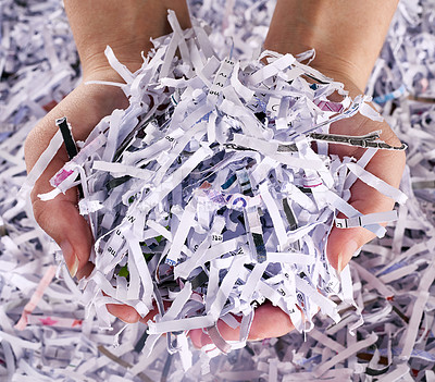 Buy stock photo Studio shot of a woman's hands holding a pile of shredded paper