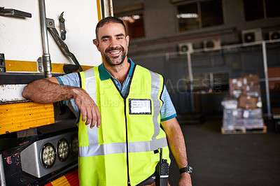 Buy stock photo Portrait of a smiling worker standing next a truck in a distribution warehouse