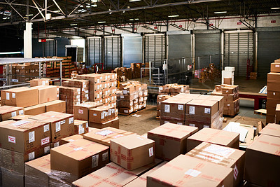Buy stock photo Shot of a large warehouse full of boxes and containers