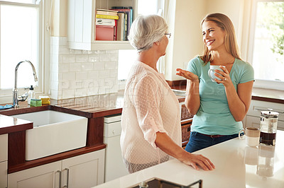 Buy stock photo Shot of an affectionate mother and daughter spending time together at home