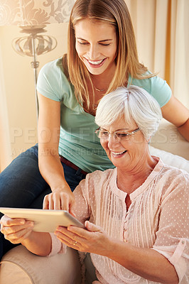 Buy stock photo Cropped shot of a senior woman and her adult daughter at home
