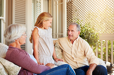 Buy stock photo Cropped shot of a young girl standing outside with her grandparents
