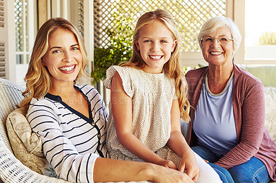 Buy stock photo Cropped portrait of a young girl sitting outside with her mother and grandmother