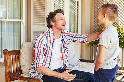 Buy stock photo Cropped shot of a father talking to his young son outside