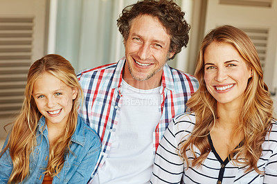 Buy stock photo Cropped portrait of a young girl sitting outside with her mother and father