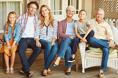 Buy stock photo Full length portrait of a family of six sitting outside
