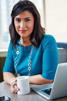 Buy stock photo Portrait of a businesswoman taking a break at her desk in an office