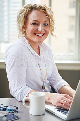 Buy stock photo Portrait of a businesswoman using a laptop in an office