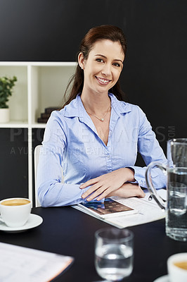 Buy stock photo Cropped shot of a businesswoman seated at her desk
