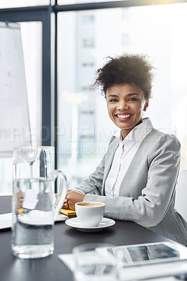 Buy stock photo Cropped shot of a young businesswomen seated at a table