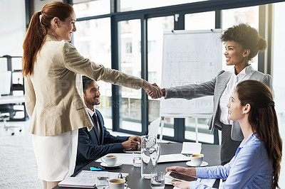 Buy stock photo Shot of businesspeople shaking hands during a meeting