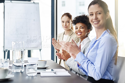 Buy stock photo Shot of three businesswomen applauding