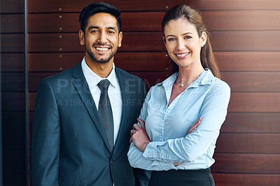 Buy stock photo Shot of two businesspeople standing outside the office